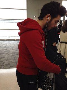 A very tired Gianluca boarding plane in Detroit 12-2-13.