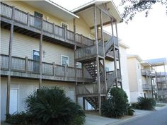 Upgraded 3 bedroom, 2 bath condo features 10 ft. ceilings, granite countertops, tile floors in all main rooms, extra crown molding, open floor plan, elevator, huge garage with lots of storage.  Fishing pier on Mobile Bay, lake and swimming pool.  Large back deck overlooking wooded area.  Convenient to interstate.
