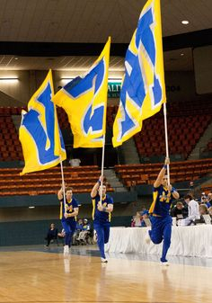 The cheerleaders run the flags during a timeout.