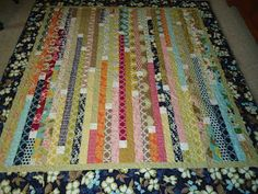 Jelly Roll Quilt I really like the white squares to define each strip