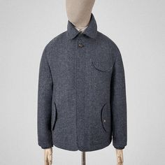 Mid-blue wool-tweed cuff coat.