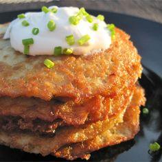 "These ""yummy"" German Potato Pancakes are ""just like Grandma used to make. No one makes potato pancakes like my grandma! German Potato Pancakes, German Potatoe Pancake Recipe, Grated Potato Pancakes, Polish Potato Pancakes, Waffles, Bratwurst Sausage, German Potatoes, Potato Latkes, Potato Dishes"