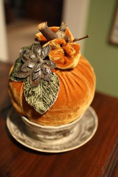 Velvet pumpkin made from a shirt sleeve and adorned with a leaf broach.