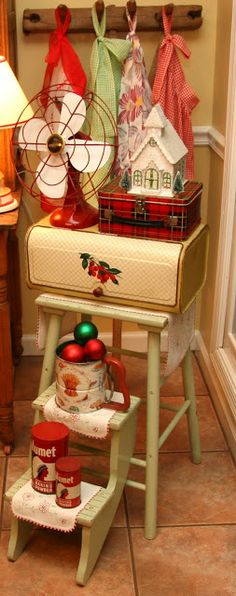 A vintage step stool in the kitchen, decorated with red and green for Christmas <3 | via Steadmans' Corner