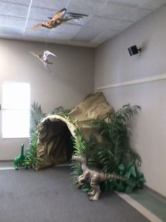 Summer reading cave - Graham Public Library A cozy corner cave with cave paintings the children made and also a great way to make reading fun!