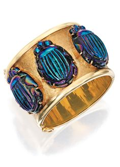 18 KARAT GOLD AND FAVRILE GLASS SCARAB BANGLE-BRACELET, PRIMAVESI & KAUFMANN The three large favrile glass scarabs applied to the textured finish bangle-bracelet, with maker's mark; late 1950s.