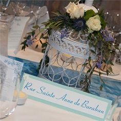 The couple celebrated their wedding at the Roxburghe Hotel in Edinburgh. They chose the venue as the location was perfect – Emilie was happy to marry outside of France, Allan was happy to marry in Scotland and the events coordinator, Kayda, was easy to work with and could accommodate the couple's requests!They chose to decorate the venue with a teal blue colour scheme and a birdcage theme. Birdcages were used as the table centrepieces, draped with Scottish themed flowers, and were featured…