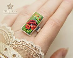 RED FLOWER handmade ring. Statement ring. Adjustable, fits any size. Rectangle floral cab; polymer clay filigree; red green white. Gift idea
