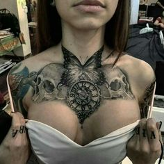 Skulls, clock, butterfly tattoo. And implants.                                                                                                                                                                                 More
