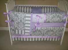 I'm not big on purple but this is pretty     Lavender and Grey Baby Bedding for Girl 4 Piece Set.