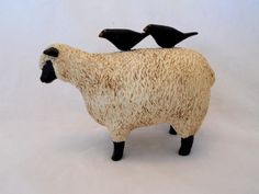 Folk art - antique carved sheep and two black birds