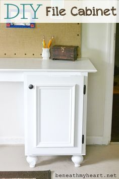 DIY File Cabinet-uses a board inside cabinet with a pull on it. Pics are on the site. Looks great.