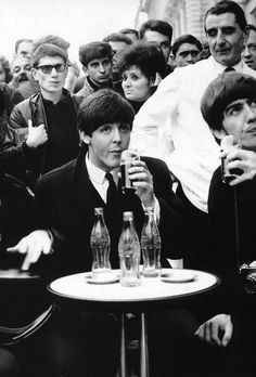 "pinkfled: "" Paul McCartney and George Harrison from The Beatles drinking coke in Paris, 1964 """