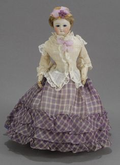 Jumeau bisque doll, ca 1860, she wears the most luscious white cotton blouse ever, paired with a cream and lilac skirt - too sweet for words. And a natural straw bonnet enhanced with lilac velvet ribbon and violets.
