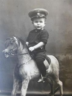 Old photograph of an Adorable BOY Military HAT Big ROCKING HORSE Toy c1910