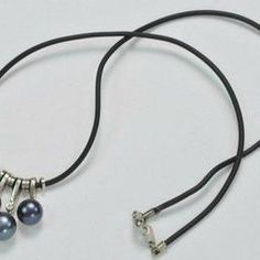 AYNRX2691:           Classic 7/8mm Black Freshwater pendant with 17.3 inches leather chain.             This item is handmade and each pearl is unique.          Symbolism:              Black Pearls represent the unknown, infinite knowledge.   $19.99