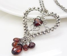 Red garnet necklace, Sterling silver garnet necklace, Dark red heart necklace, Wire wrapped jewelry, Handmade garnet jewelry.. $175.00, via Etsy.