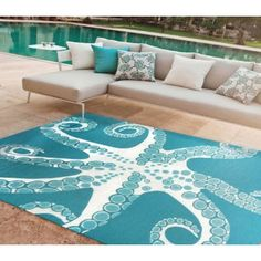 This 5 x 8 indoor-outdoor deep aqua and white area rug decorated with 8 reaching arms of a tentacled octopus is simply fabulous