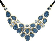 http://www.shefinds.com/files/2012/10/Joan-Rivers-Simulated-Drusy-bib-necklace-531x400.jpg