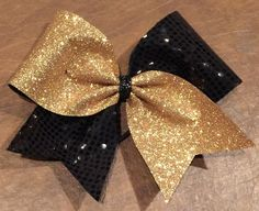 Cheer Bow - Gold Glitter Black Sequin Tic Toc by FullBidBows on Etsy https://www.etsy.com/listing/262484457/cheer-bow-gold-glitter-black-sequin-tic
