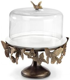 Hand cast aluminum base with bronze finish. Glass dome and ivory ceramic plate. SKU# This item will be back in stock after April What Customers Say About Whimsical Butterfly Cake Stand Beautiful Piece! Cake Stand With Dome, Cake Pop Stands, Vintage Cake Stands, Cupcake Stands, Butterfly Cakes, Butterfly Decorations, Butterfly Kisses, Butterflies, Pedestal Cake Stand