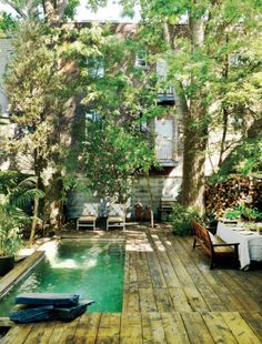 Lush, decked city garden with a plunge pool