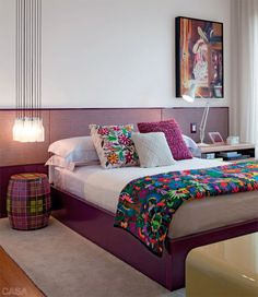 Eggplant paint color in the bedroom - textured textiles add pops of color.