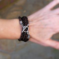 **This is a RESERVED listing for Marko. If you are not Marko, please do not purchase**      Naturally dyed* brown leather is round braided and wraps around four times for this custom sized bracelet. It's accented with a sterling silver hand forged toggle clasp that I have oxidized and hammered to add rough, rustic detail. A cool casual bracelet for a man or woman.    Leather braid is 5 mm thick    See more leather wrap bracelets here…