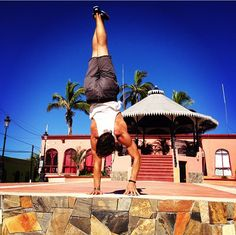 Baja handstand on retreat with Patrick Beach and Carling Harps at Prana del Mar