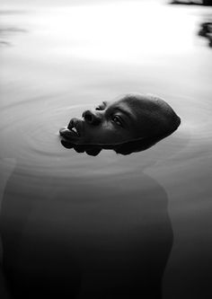 Djimon Honsou | Fabrizio Ferri | beautiful | Silent | love | soft | still | swim | black & white | photography | simplicity | happiness