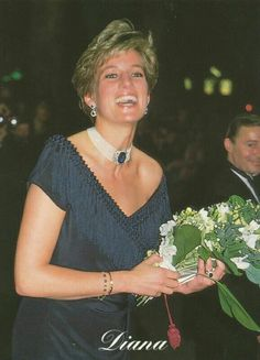 1991: Princess Diana at the Royal Albert Hall, dressed in a navy short cocktail evening dress..