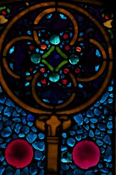 Detail from a stained glas window at First Parish, a Unitarian church in Brookline, Mass., whose origins go back to the early 1700s.
