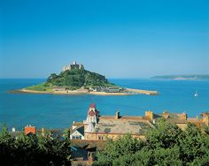 """St Michael's Mount's Cornwall: Cornish name means """"grey rock in the woods"""", and may represent a folk memory of a time before Mount's Bay was flooded. Cornwall England, England Uk, The Places Youll Go, Places To See, Uk Landscapes, St Michael's Mount, St Just, Castles In England, Ville France"""