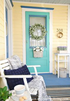 spring porch, farmhouse porch, spring decorating ideas, spring home tour, country porch, yellow house, blue door, aqua door, wreath