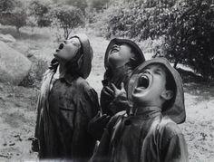 Children singing in the rain by Barbara Morgan, 1950