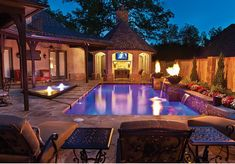 pool with fire features at night Baker Pools OK Aquatech