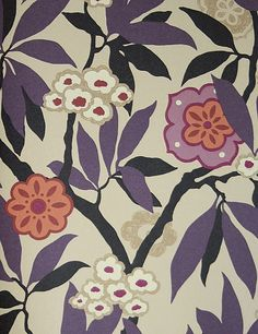 Primavera Wallpaper Stylised fruit and flower design in plum and chocolate on a sand background, taken from a 1926 Art Deco design