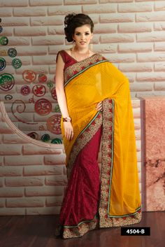 Attractive yellow shaded with red net designer saree comes with golden embroidery