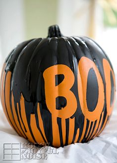Add to spooky decorations with this boo-tiful pumpkin. Just grab some black paint and duct tape to create your own. Get the tutorial at House of Joyful Noise.