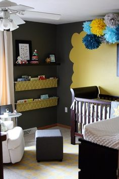 "The combination of grey and yellow is one of our favorites and is a perfect choice for the office/nursery Melanie will be sharing with ""Dos"" her second child about to arrive (a week overdue!).  Here's Melanie's description: the nursery space for our second child is half of a larger room that is also half my office/studio space. I went with a yellow and grey color scheme as well as pops of turquoise."