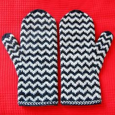 Ravelry: Petit-Noir's monochrome chevron love mittens (there's a link to the paid pattern)
