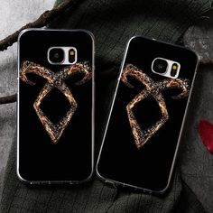 Shadowhunters Phone Case - Golden Rune This case is like a Glamour spell - just put in on, and your phone will instantly look so much cooler! And is protected against all kinds of accidents. (Not against demon attacks though. Please ask your local Institute for help and protection if one happens.)Fits most popular phones, looks great (even for mundanes) and keeps your phone safe. What are you waiting for? Order it today with free shipping!