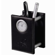 - Functional 2-in-1 design - Modern clock display - Space for writing instruments, letter opener, etc. - Batteries included - Individually gift boxed