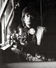 Self-portrait of John Lennon and his Rolleiflex in the attic of his house Kenwood, June 29, 1967
