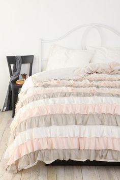 über feminine ruffle duvet cover in pale pink, grey, & white. 
