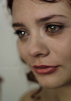 Tears glistened in her eyes as she watched the scene before her unfold with a defined certainty. It was heart breaking; but she wasn't going to stop it. It was for the greater good, after all.