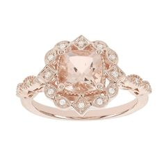 Fall in love with this great alternative to the traditional ring. The engagement ring features a cushion cut morganite center with lovely hues of soft pink surrounded by dazzling diamonds. The 14k rose gold and halo design complement this beautiful look.