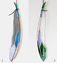 Diamondeye Stained Glass Feather   Dangle this handsome stained glass feather from its faux leath...   Stained Glass Panels