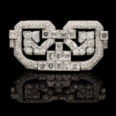 CARTIER.circa 1930.Art Deco diamond placque brooch