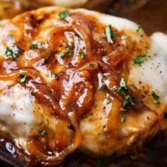 One Pan French Onion Smothered Pork Chops   Juicy pan-seared pork chops, smothered in caramelized onion sauce and 2 kinds of gooey cheese. It's easy to break out of a dinner rut with this fun weeknight meal!   The Chunky Chef   #porkchops #porkchopsrecipe #onepan #onepot #frenchonion #weeknightmeal
